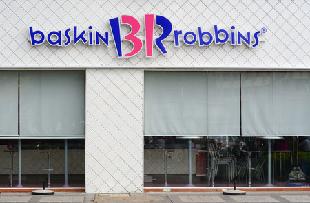robins: Saigon Vietnam  Jun 23 2015. Baskin Robins icecream shop in Saigon downtown Vietnam. The ice cream parlor franchise exists since 1945 and has 5800 locations in 30 countries.