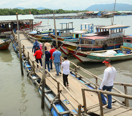 snorkelling: Nha Trang Vietnam  Jun 21 2015. Tourists waiting at the pier for boarding to the fishing boats after the snorkelling trip in Nha Trang Vietnam. Editorial