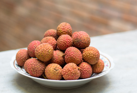 litschi: Famous tropical fruit - lychee - fresh and sweet on the table Stock Photo