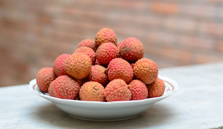 leechee: Famous tropical fruit - lychee - fresh and sweet on the table Stock Photo
