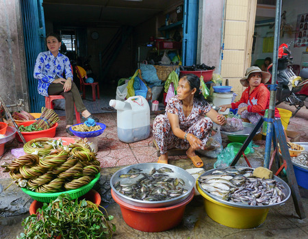 forage fish: Mekong Delta, Vietnam - Jun 20, 2015. Unidentified women selling fresh fishes and vegetables at the local market in Mekong Delta, Vietnam.