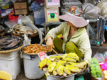 fishery products: An Giang, Vietnam - Jun 29, 2015. Dried fish with salt and spice added, the popular food for rural people in Mekong delta, south of Vietnam, on sale in a shop in Chau Doc city. Editorial