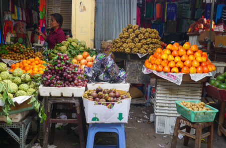 Hanoi, Vietnam - June 20, 2015. Fruit stalls at a local market in Hanoi. In 2004, agriculture accounted for 21.8 percent of Vietnams GDP.