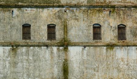 bodhgaya: Windows in the wall of the old building in Bodhgaya, India.