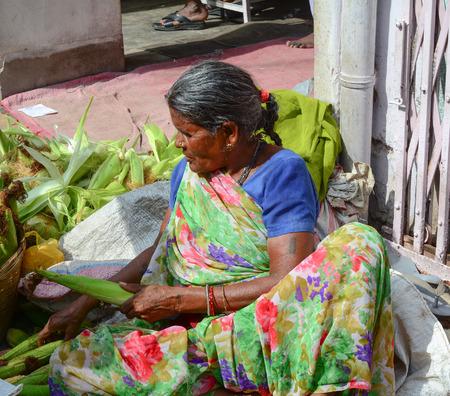 common market: Bodhgaya, India - Jul 12, 2015. Unidentified women selling vegetables in a crowded market in Bodhgaya, India. Its a common practice in India to sell vegetables in open markets and streets.