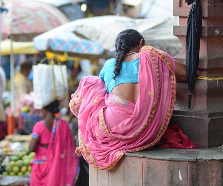bodhgaya: Gaya, India - Jul 22, 2015. Unidentified women sitting on the street near by the market in Bodhgaya, India.