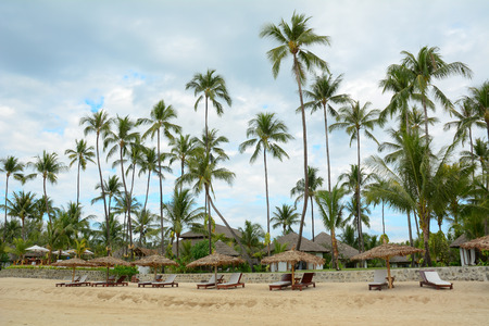Beautiful beach resort with many coconut trees in Ngwesaung Beach on the west coast (Bengal Bay) of Myanmar (Burma).