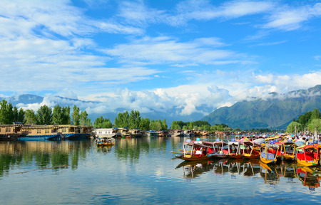 SRINAGAR, INDIA - JUL 21, 2015. Lifestyle in Dal lake, local people use 'Shikara', a small boat for transportation in the lake of Srinagar, Jammu and Kashmir state, India.