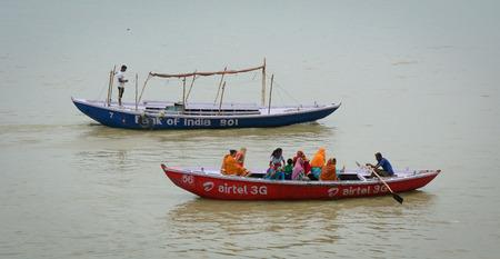 benares: Varanasi, India - Jul 12, 2015. Indian tourists taking the popular boat tour on the sacred Ganges river in Varanasi, Uttar Pradesh, India. Editorial