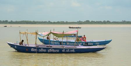 uttar: Varanasi, India - Jul 12, 2015. Indian tourists taking the popular boat tour on the sacred Ganges river in Varanasi, Uttar Pradesh, India. Editorial