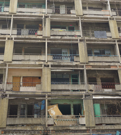 casement: SAIGON, VIETNAM - MARCH 5, 2015. Old apartment buildings in Ho Chi Minh City. Impression scene of cement wall, group of aged window, air conditioner, block downgrade. Editorial
