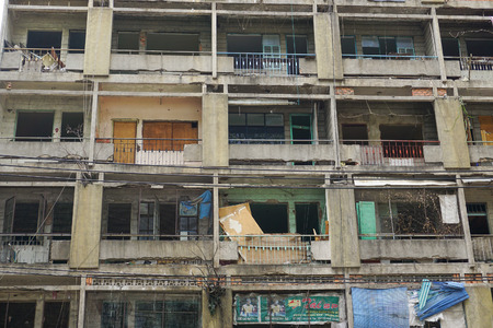 downgrade: SAIGON, VIETNAM - MARCH 5, 2015. Old apartment buildings in Ho Chi Minh City. Impression scene of cement wall, group of aged window, air conditioner, block downgrade. Editorial
