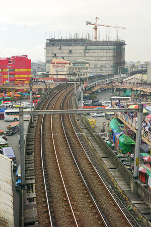 railtrack: MANILA, PHILIPPINES - APRIL 22, 2015. LRT railtrack at EDSA train station in Manila, Philippines. LRT serves 579,000 passengers each day. Its 31 stations along over 31 kilometers.