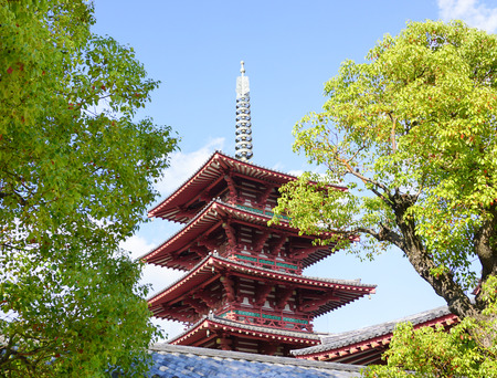 administered: OSAKA, JAPAN - OCTOBER 24, 2015. Shitennoji Temple in Osaka, Japan. Constructed in 593, the temple is the first Buddhist and oldest officially administered temple in Japan.