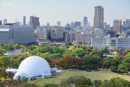 billion: Osaka, Japan - Aug 11, 2015. View of Osaka downtown and Osaka Business Park in the autumn. The GDP in the greater Osaka area is $341 billion.