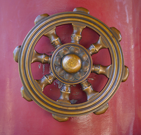 samsara: Wheel of Dharma, one of eight auspicious Buddhist religious symbols in Japanese temple.