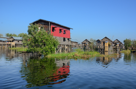 entrapment: Traditional wooden stilt houses at the Inle lake, Shan state, Myanmar. Inle Lake is a major tourist attraction, and this has led to some development of tourist infrastructure.