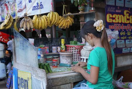 intoxicate: YANGON, MYANMAR - JAN 30, 2015. Street vendor selling breakfast and betel leaves at Yangon bus station in Myanmar (Burma). Editorial