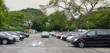 Singapore - Jun 22, 2015. Car parking lot at bus terminal in Singapore. The per-capita car ownership rate in Singapore is 12 cars per 100 people (or 1 car per 8.25 people).