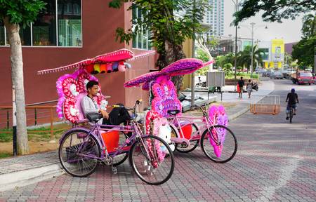 trishaw: MALACCA, MALAYSIA - AUG 22, 2015. Decorative trishaw at Malacca city in Malaysia. Malacca has been listed as a UNESCO World Heritage Site since 7 July 2008.