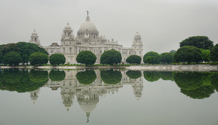 water feature: View of the Victoria Memorial and its reflection in the water feature in the foreground. Built by the British during colonial times it is a prominent feature in Kolkata.