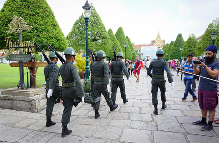 wang: BANGKOK, THAILAND - MAR 27, 2015. Kings Guards are marching in Grand Royal Palace in Bangkok, Thailand. Palace was the residence of Siam Kings, now used for official events. Editorial
