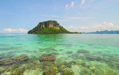 blue waters: Beautiful beach with crystal clear blue waters of the Andaman sea against blue sky at Krabi bay, Thailand. Stock Photo