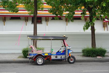 amasing: BANGKOK, THAILAND - JULY 29, 2015. Traditional street taxi (tuk-tuk) awaits passengers on a street in Chinatown in Bangkok. In Bangkok, there are more than 100,000 (tuk-tuk).