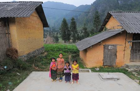 multiple ethnicities: SAPA, VIETNAM - JUL 23, 2014. Ethnic Hmong children in Sapa, Vietnam. Hmong children often work on the field since childhood. Editorial