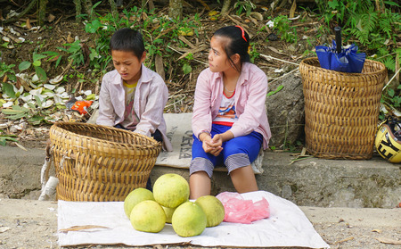 ha giang: Ha Giang, Vietnam - Oct 6, 2014. Hmong women selling vegetables on street in Ha Giang, Vietnam. Hmong are the 8th largest ethnic group in Vietnam. Editorial