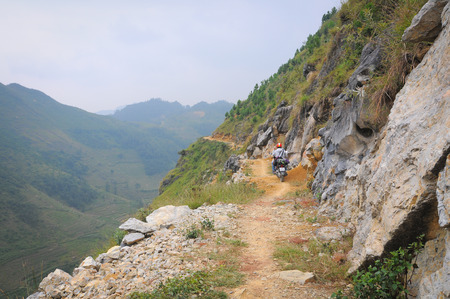 ha giang: Ha Giang, Vietnam - May 10, 2015. Motorbikes running on the mountain road in Ha Giang, Vietnam. Ha Giang is located in the far north of the country, and contains Vietnams northernmost point.