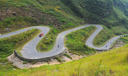 ha giang: Motorbikes running on the mountain road in Ha Giang, Vietnam. Ha Giang is located in the far north of the country, and contains Vietnams northernmost point.