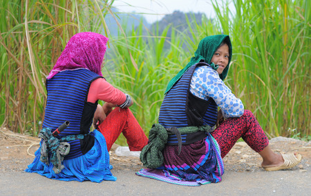 ha giang: HA GIANG, VIETNAM - SEP 2, 2015. People sitting on countryside road after finish work in Ha Giang, north of Viet Nam. Editorial