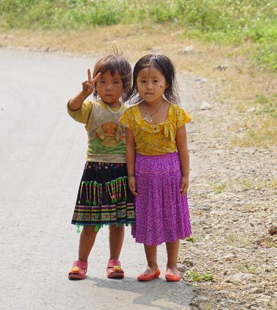 multiple ethnicities: SAPA, VIETNAM - JUL 23, 2014. Portrait of Ethnic Hmong children in Sapa, Vietnam. Hmong children often work on the field since childhood.