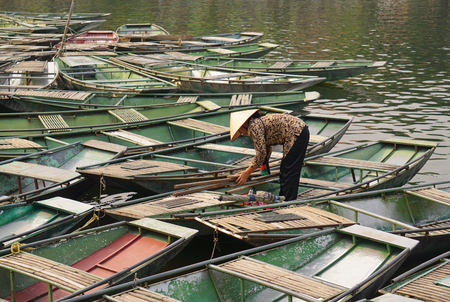 tam: Ninh Binh, Vietnam - Oct 22, 2014. Vietnamese boats on the river early in the morning in Tam Coc, Ninh Binh. Tam Coc is a popular tourist destination near the city of Ninh Binh in northern Vietnam.