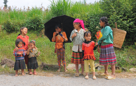 ha giang: SAPA, VIETNAM - JUL 23, 2014. Portrait of Ethnic Hmong children in Sapa, Vietnam. Hmong children often work on the field since childhood.