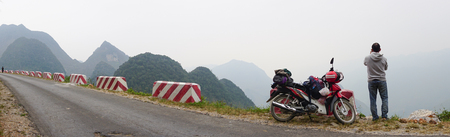 ha giang: Ha Giang, Vietnam - May 10, 2015. A man and his motorbike on the mountain road in Ha Giang, Vietnam. Ha Giang is located in the far north of the country, and contains Vietnams northernmost point. Editorial