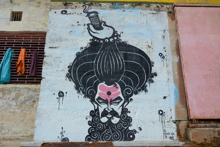holiest: Varanasi, India - Jul 12, 2015. Graffiti on the ghats of Varanasi, India. The spiritual capital of India, it is the holiest of the seven sacred cities in Hinduism and Jainism.