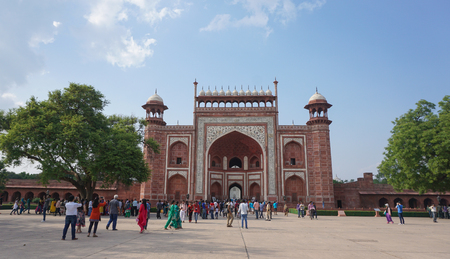 jehan: Agra, India - Jun 3, 2015. Tourists visit at the gate of Taj Mahal in Agra, India. It is one of the world's most celebrated structures and a symbol of India's rich history.