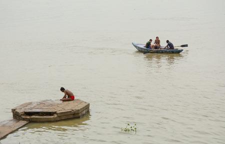 varanasi: Varanasi, India - Jul 12, 2015. Indian tourists taking the popular boat tour on the sacred Ganges river in Varanasi, Uttar Pradesh, India. Editorial