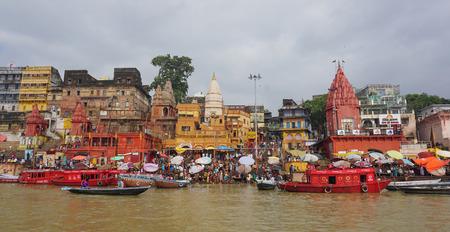 VARANASI, INDIA - AUG 12, 2015. Boats on the Ganges river in the auspicious festival at the ghats in Varanasi, Uttar Pradesh, India.
