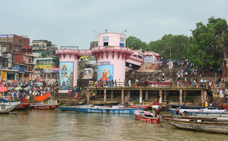 benares: VARANASI, INDIA - AUG 12, 2015. Boats on the Ganges river in the auspicious festival at the ghats in Varanasi, Uttar Pradesh, India.