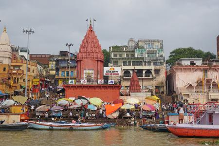 uttar: VARANASI, INDIA - AUG 12, 2015. Boats on the Ganges river in the auspicious festival at the ghats in Varanasi, Uttar Pradesh, India.