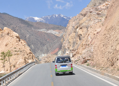 neighboring: Yunnan, China - Jun 1, 2014. Road tunnel in Yunnan province, China. Yunnan is planning to focus on the upgrading and expansion of 6 trunk roads leading to other provinces and neighboring countries.