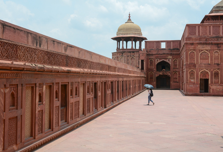 accurately: AGRA, INDIA - APRIL 12, 2015. Indian people visit Agra Fort, World Heritage site. The fort was built by the Mughals, can be more accurately described as a walled city in Agra, India. Editorial