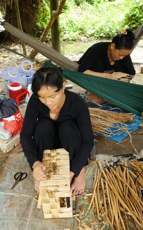 matting: BEN TRE, VIET NAM- JUNE 1, 2015. Asian people work inside coir mat workshop. Vietnamese women work traditional craft, coconut matting to export, coconut fiber material at Mekong Delta, Vietnam.