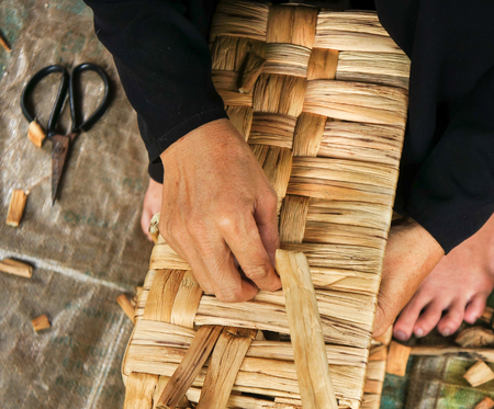 matting: Asian people work inside coir mat workshop. Vietnamese women work traditional craft, coconut matting to export, coconut fiber material at Mekong Delta, Vietnam.