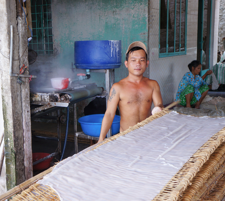 can tho: CAN THO, VIETNAM - NOV 10, 2014. Unidentified people making rice noodles in Mekong delta in Can Tho, Vietnam. Editorial