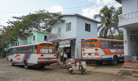 cheaper: Yangon, Myanmar - Aug 22, 2015. Vehicles parking at the bus station in Yangon, Myanmar. Buses in Myanmar are usually faster and cheaper than trains.