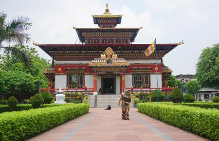 bodhgaya: Bodhgaya, India - July 22, 2015. Indian woman visit the traditional Bhutanese Buddhist temple in Bodhgaya, India. Editorial